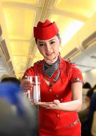 24541110-a-shot-of-flight-attendant-serving-people-on-airplane
